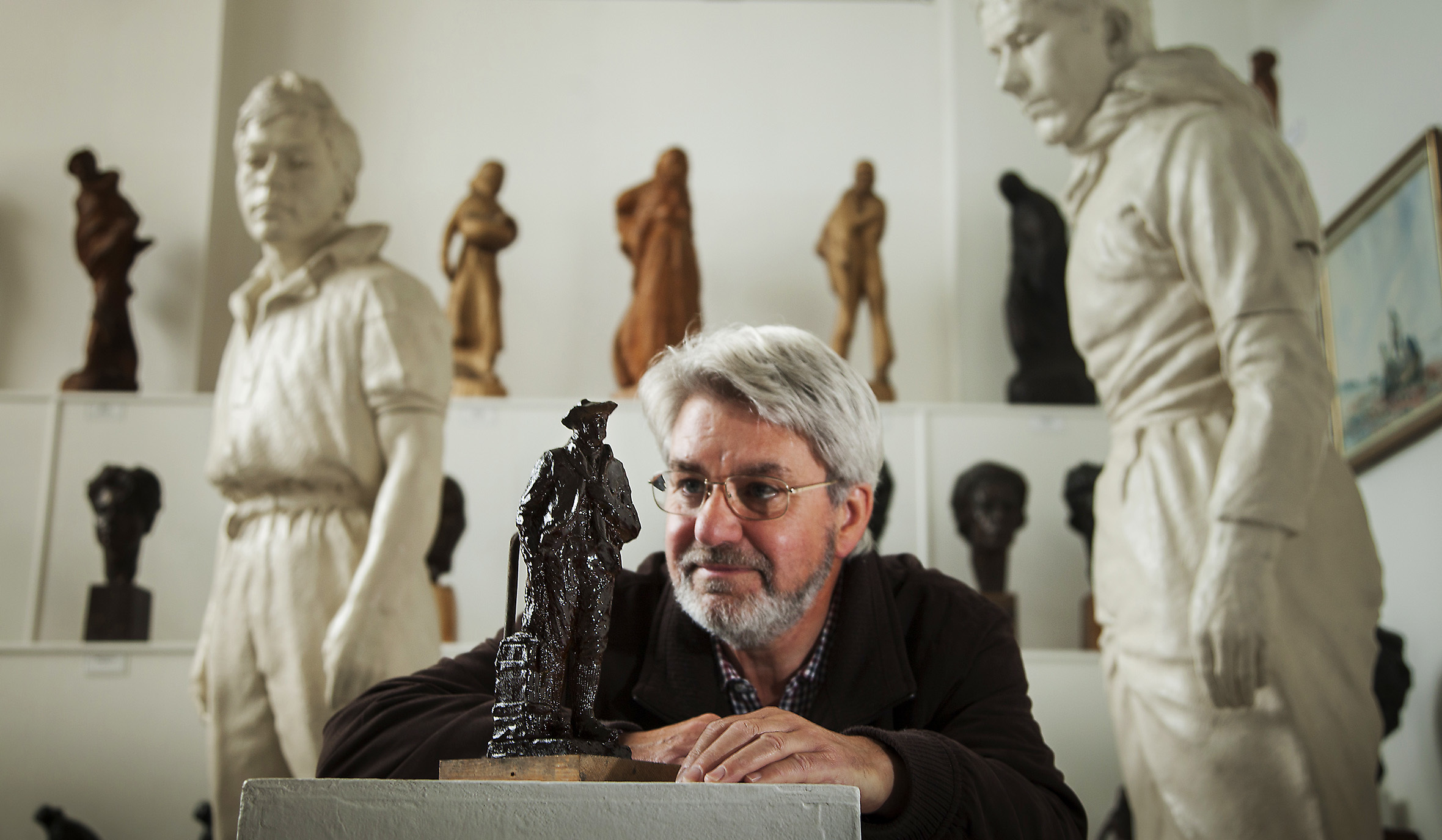 Norman Atkinson OBE with the plasticine figure, which will be stored after casting.