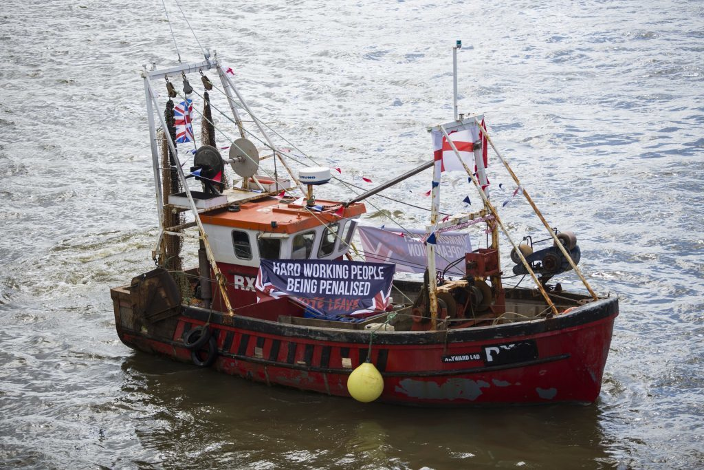 A boat decked out in flags and banners from the 'Fishing for Leave' campaign.