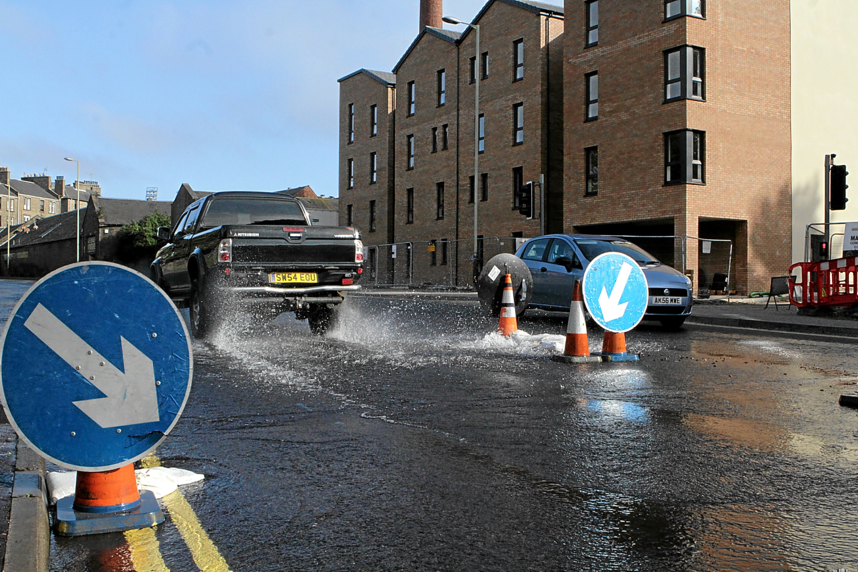 The burst water pipe on Dens Road at the junction with Alexander Street.