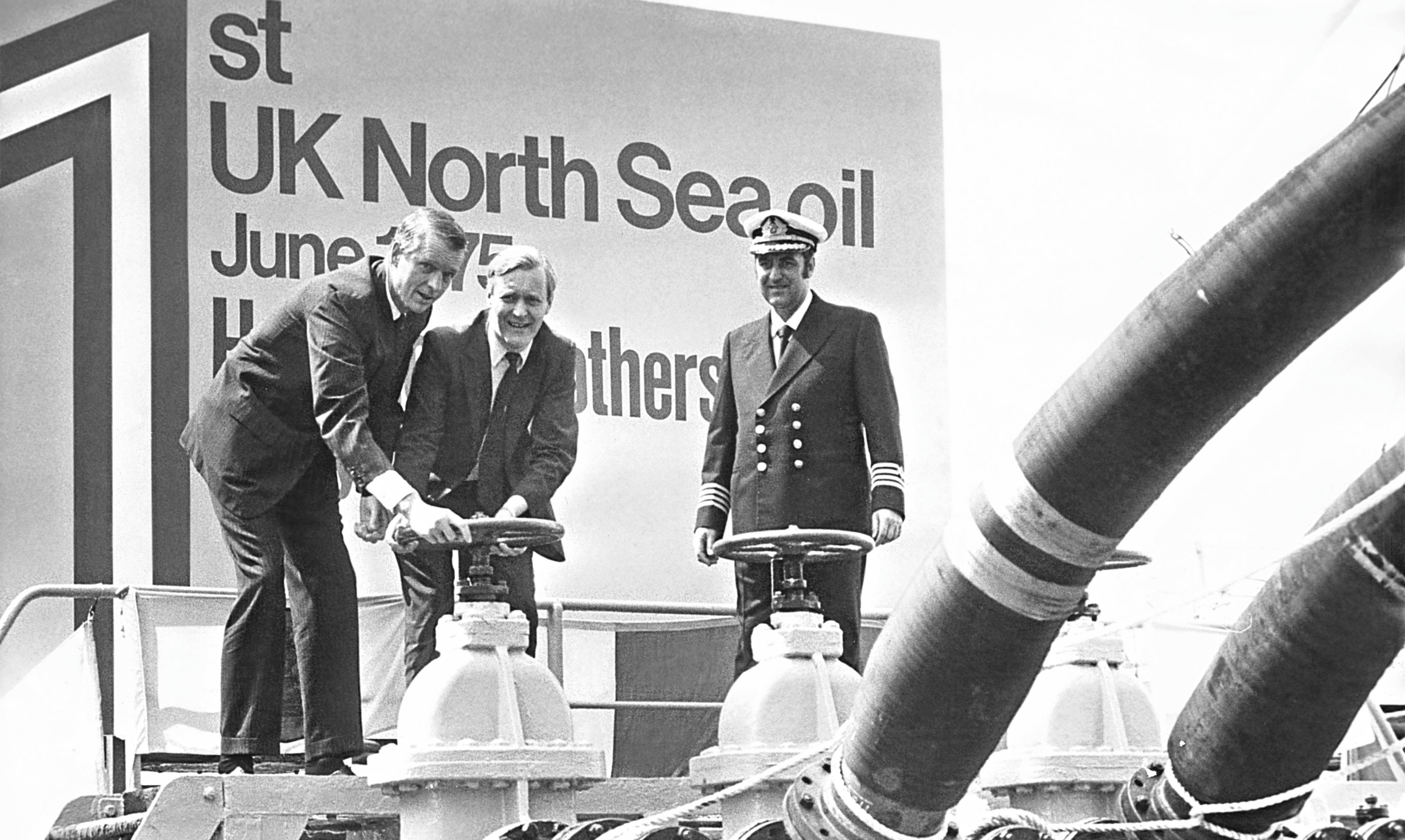Former Energy Secretary Tony Benn opens a valve to release the firstoil from the Argyll field in the North Sea.