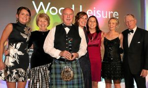 The Wood family celebrate their awards success with Lesley Larg of Thorntons and 2015 host Nick Hewer.