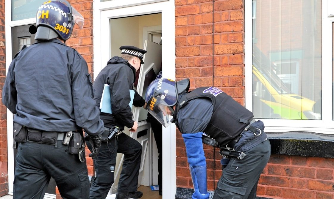 Police raid homes in Merseyside as part of ATM investigation.