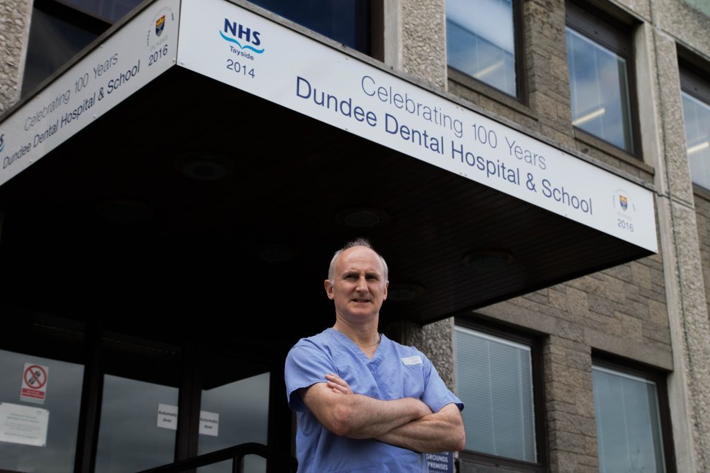 Professor Paul Mossey outside the Dundee Dental School and Hospital