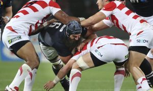 Josh Strauss tries to power a way through Japan's defence in the second test.