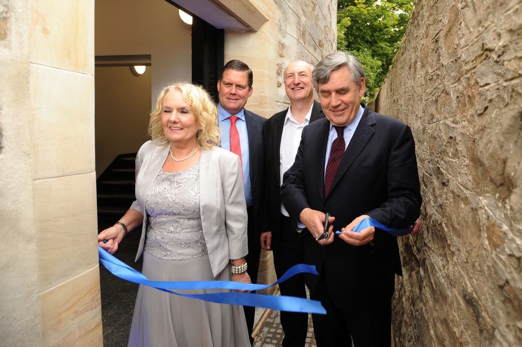 Cutting the ribbon to mark the event - l to r - Marilyn Livingstone (Chief Executive, Adam Smith Global Foundation), Michael Levack (Chairman, Adam Smith Global Foundation), Councillor Neil Crooks and Gordon Brown.