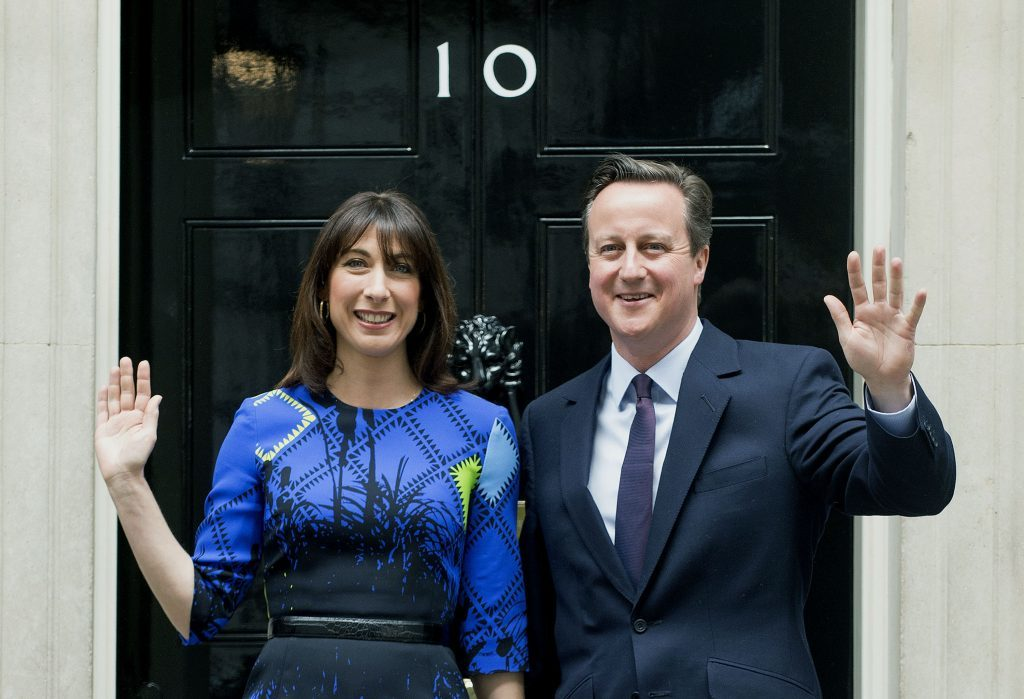 Prime Minister David Cameron arrives at 10 Downing Street, London, with his wife Samantha, following an audience with Queen Elizabeth II at Buckingham Palace, to confirm his second term as Prime Minister following his party's General Election victory.