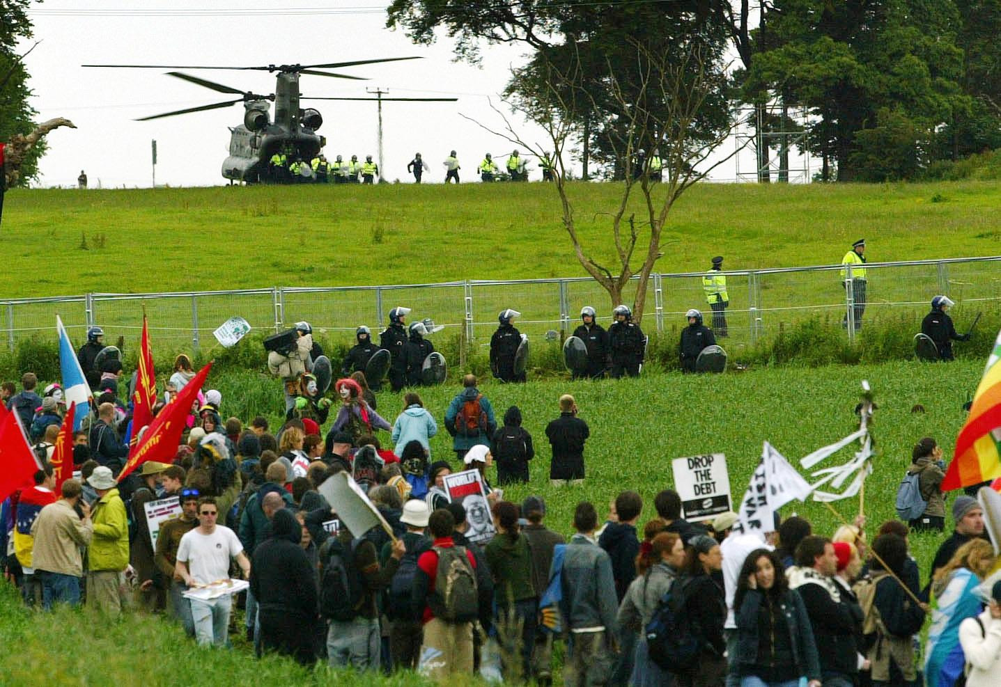 Police reinforcements are drafted in by helicopter, after protestors breached the security fence at Auchterarder during the G8 summit at Gleneagles in 2005.