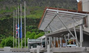 Flags at half mast outside Scottish Parliament after Labour MP Jo Cox was shot and stabbed to death in the street outside her constituency advice surgery in Birstall, West Yorkshire.