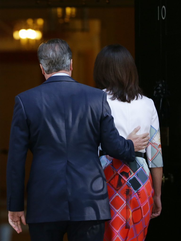 Prime Minister David Cameron heads back into Downing Street with wife Samantha after confirming his intention to resign.