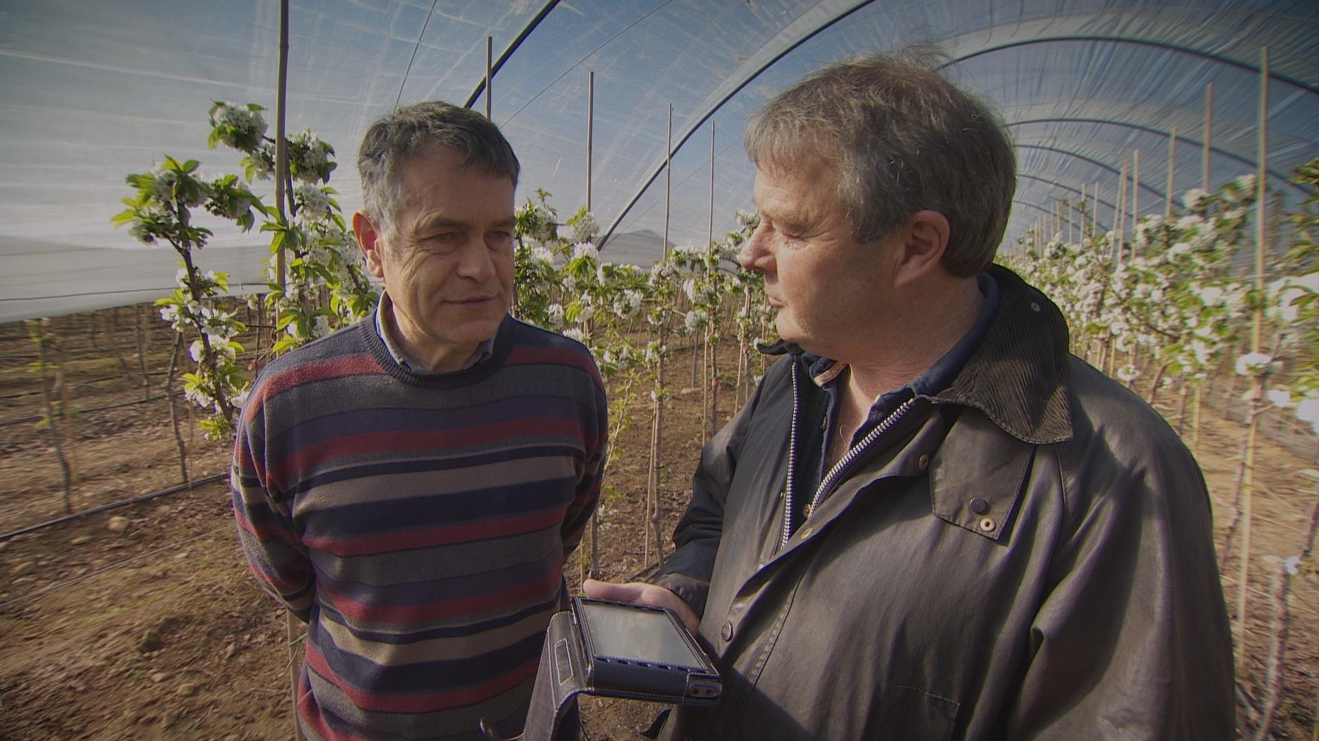 Farmer Peter Thomson, left, interviewed by Landward presenter Euan McIlwraith.
