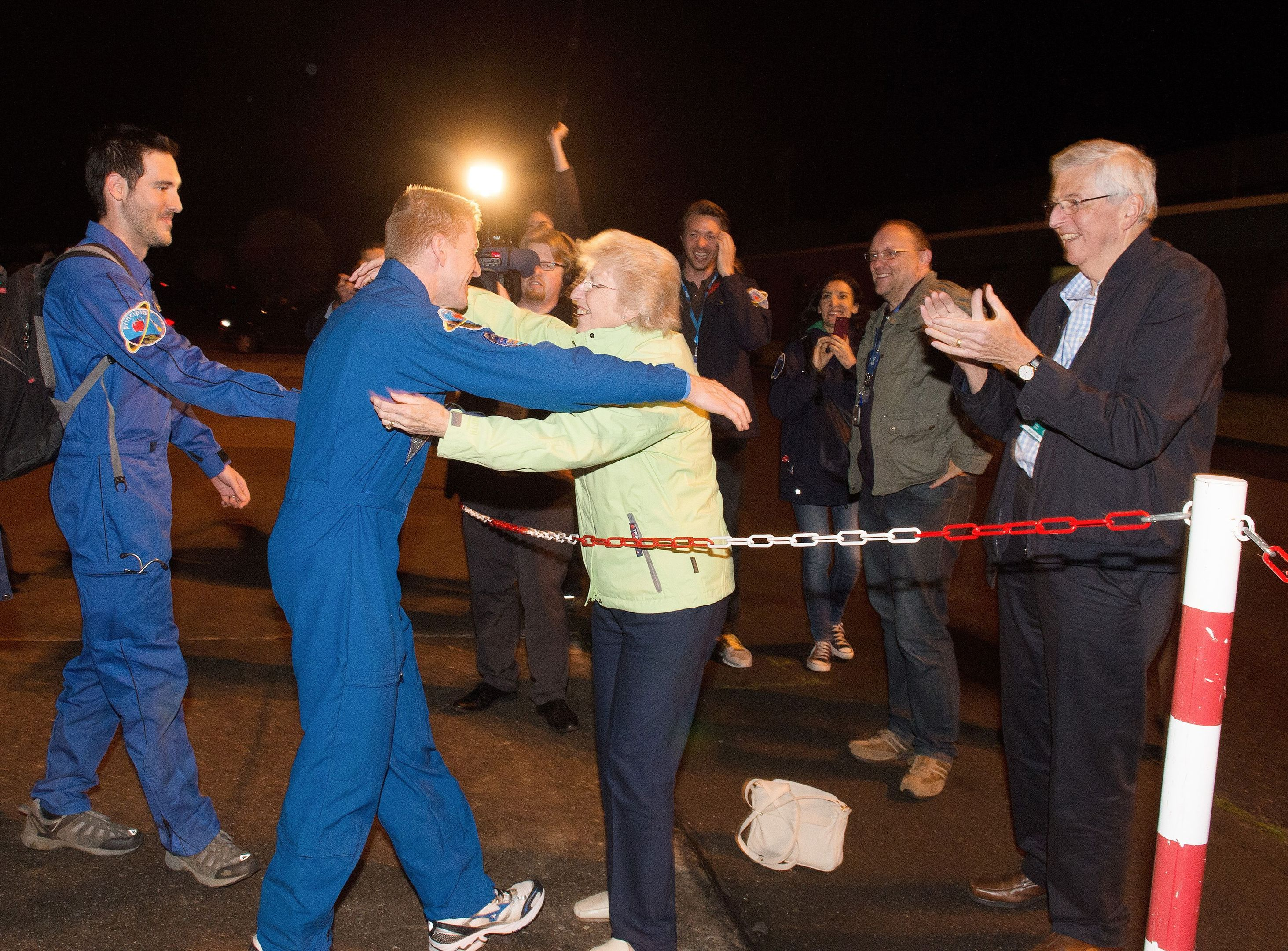 Major Tim Peake is reunited with his mother Angela and father Nigel (right) as he arrives at Cologne airport in Germany.