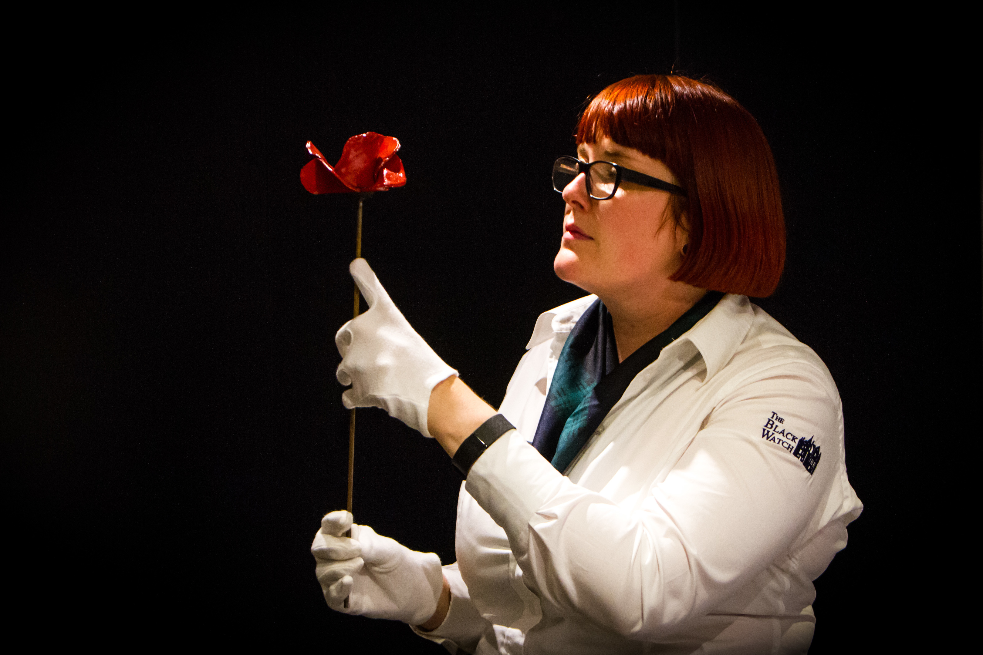 Black Watch museum manager Emma Halford-Forbes, with one of the ceramic poppies. This particular poppy has been gifted to the museum and will go on permanent display at the castle.