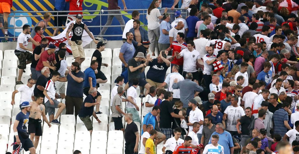 Tempers flare between rival fans in the stands during the UEFA Euro 2016, Group B match at the Stade Velodrome, Marseille. PRESS ASSOCIATION Photo. Picture date: Saturday June 11, 2016. Russia are facing serious UEFA sanctions after their fans appeared to attack England supporters at the end of Saturday's Euro 2016 clash. See PA story SOCCER England Fans. Photo credit should read: Owen Humphreys/PA Wire. RESTRICTIONS: Use subject to restrictions. Editorial use only. Book and magazine sales permitted providing not solely devoted to any one team/player/match. No commercial use. Call +44 (0)1158 447447 for further information.