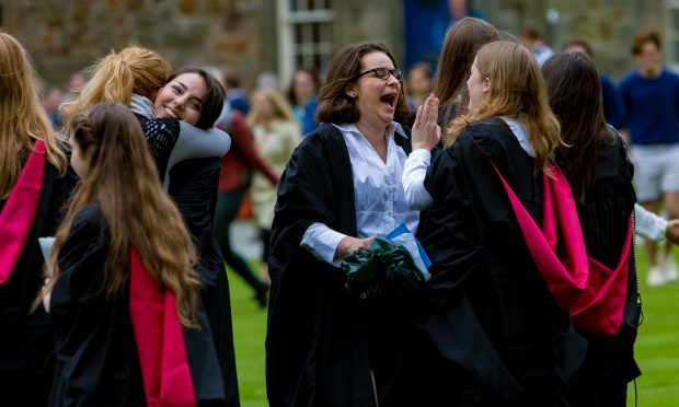 Students celebrate in St Salvators Quadrangle.