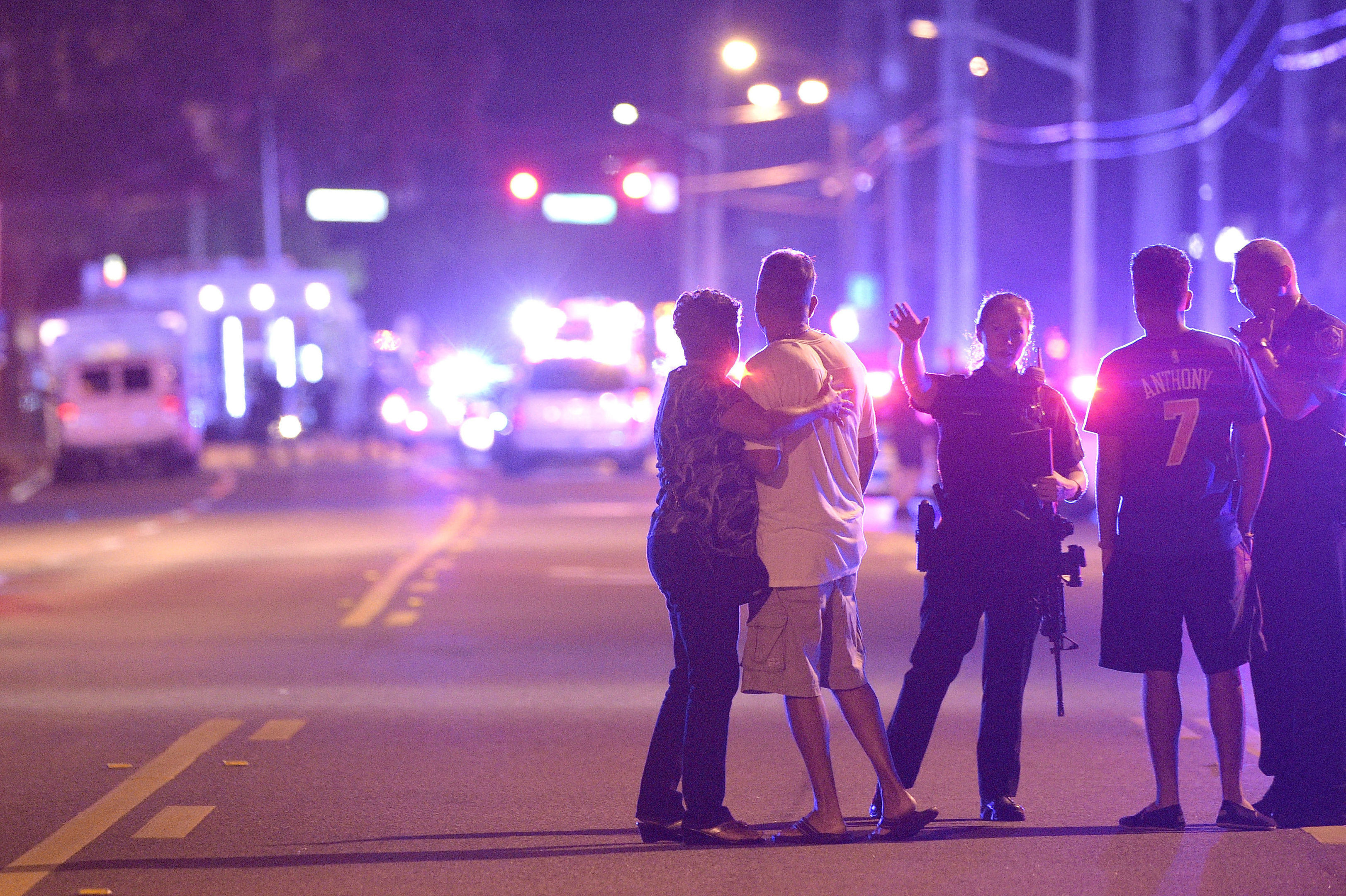 Orlando Police officers direct family members away from a multiple shooting at a nightclub in Orlando,.