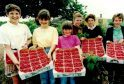 These raspberry pickers show off their great haul at Morrison's Farm, Slatefield in Forfar in July 1991.