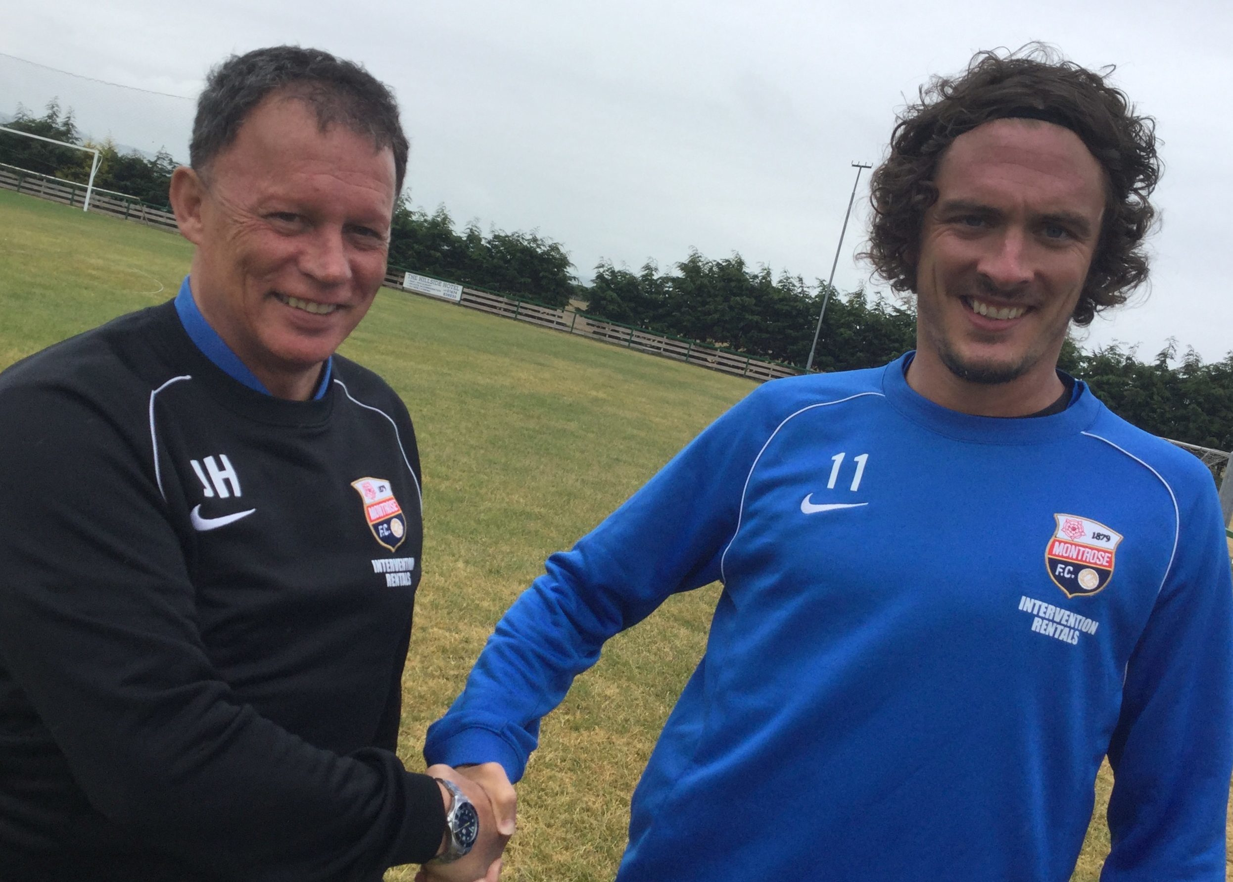Montrose assistant boss John Holt, left, welcomes Allan Fleming to the club.