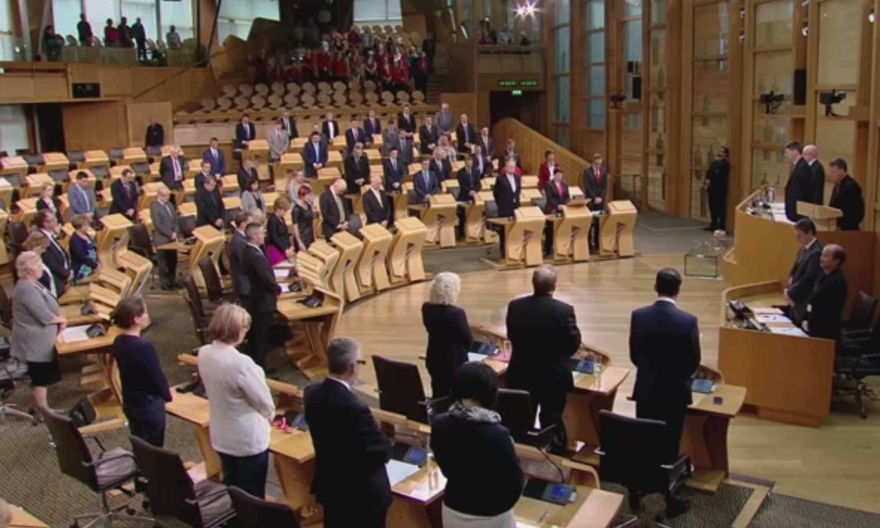 MSPs stand to observe a minute's silence in tribute to the victims of the Orlando shootings.