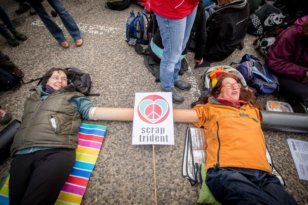 Anti Trident protestors blockade the Faslane submarine base, home of the Trident nuclear missiles.