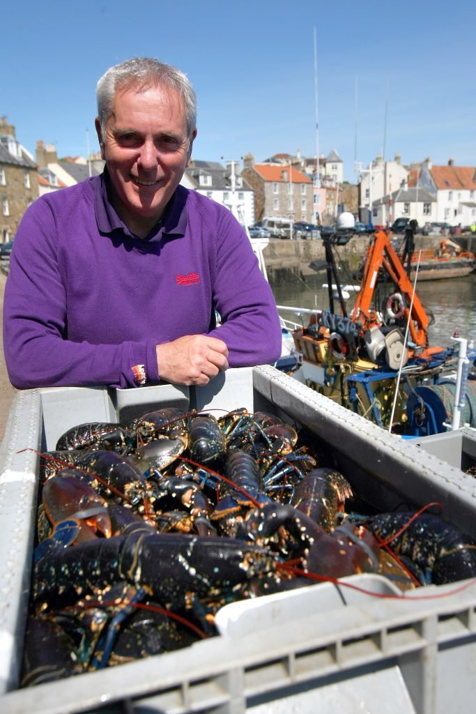 Tom Mackenzie with freshly landed shellfish at Pittenweem Harbour