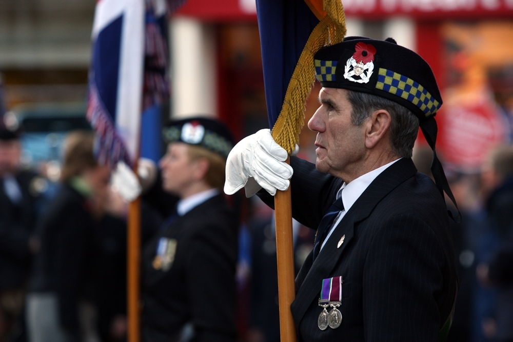 Mr McKeown with the colours at Remembrance Day services in Forfar in 2010