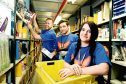 David Clunie, Chris Stewart and Paige Crosbie picking orders at Amazon's Dunfermline fulfilment centre