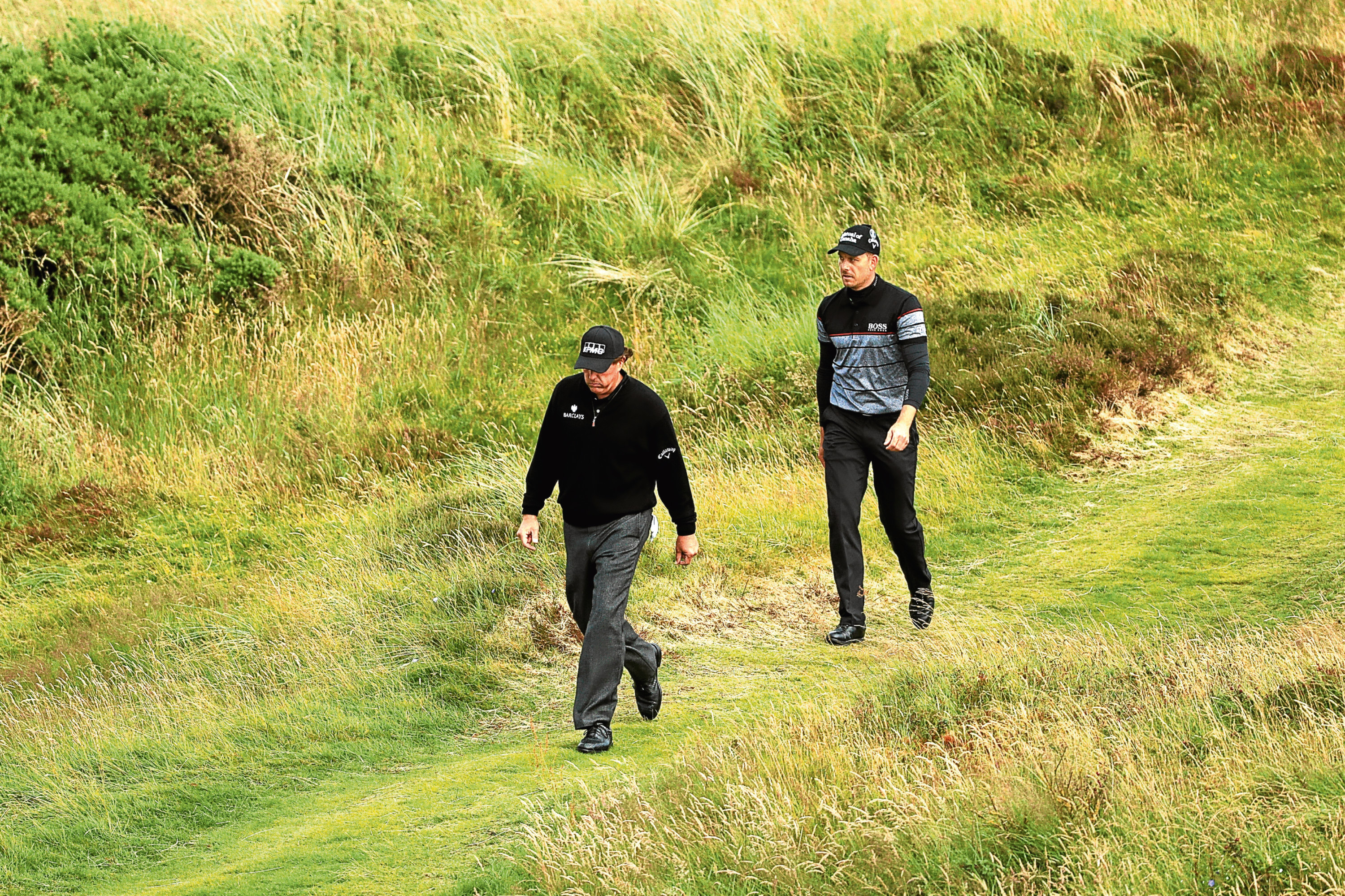 Phil Mickelson and Henrik Stenson during their duel in the dunes at Royal Troon.