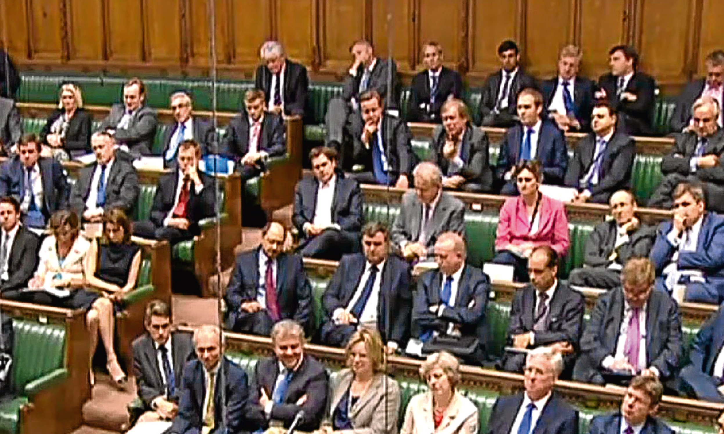 Just another backbencher. David Cameron, centre with his head resting on his hand, watches the Trident debate in the Commons from afar.