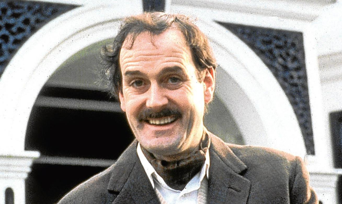 John Cleese as Basil Fawlty.