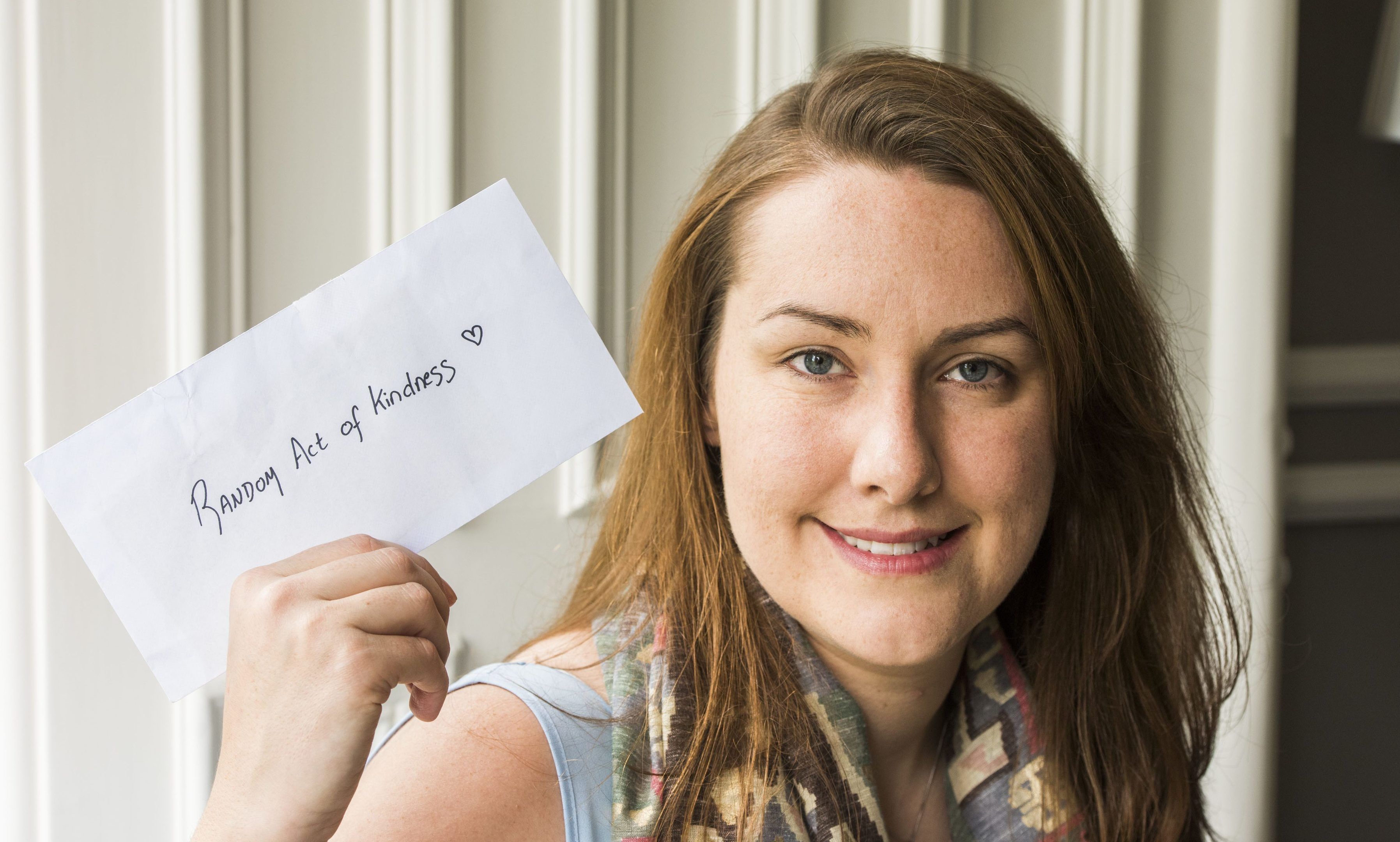 Emma Storrar with the envelope from Fiona Munro