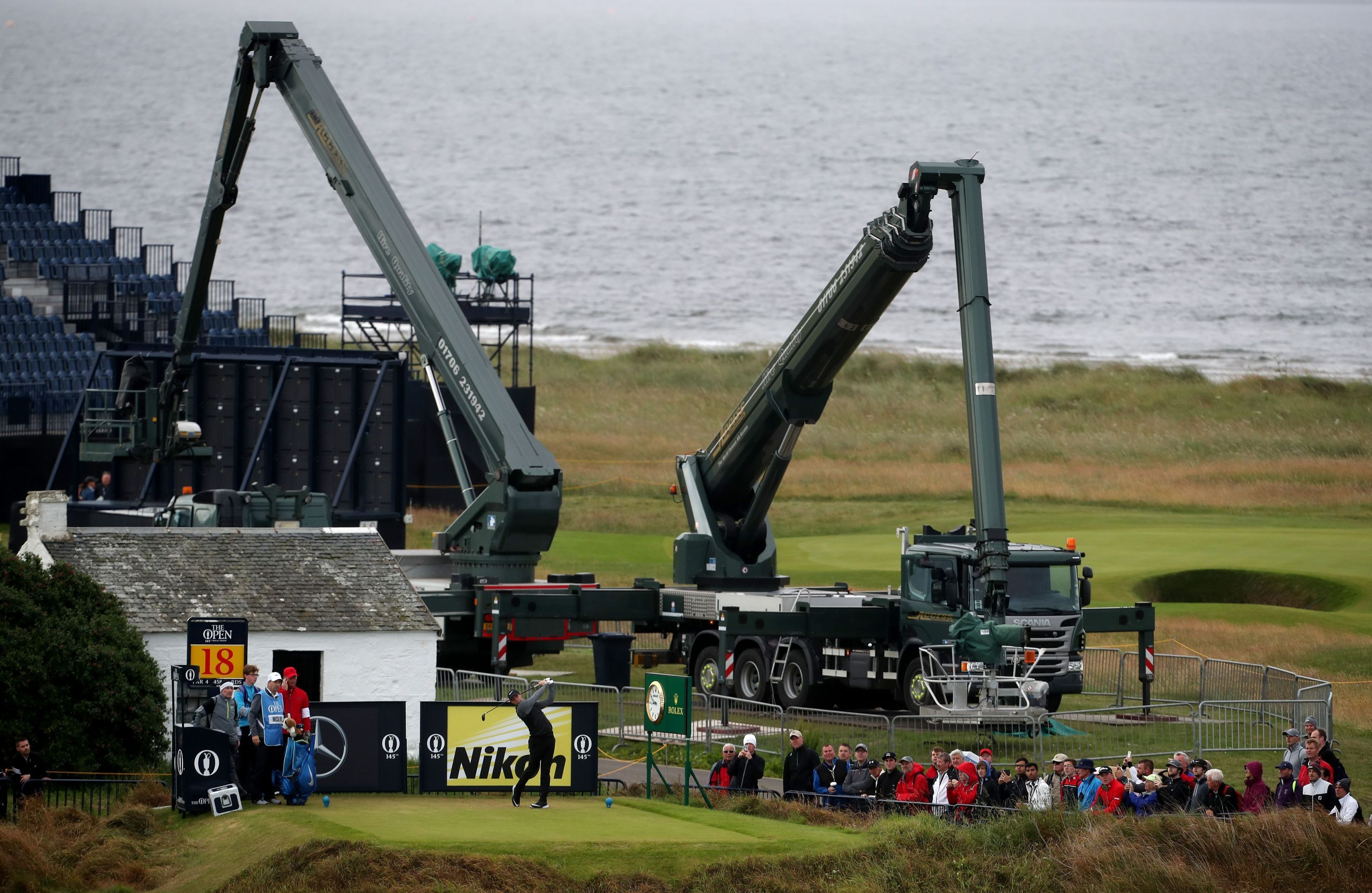 Rory McIlroy tees off the 18th during the final practice day at Royal Troon.
