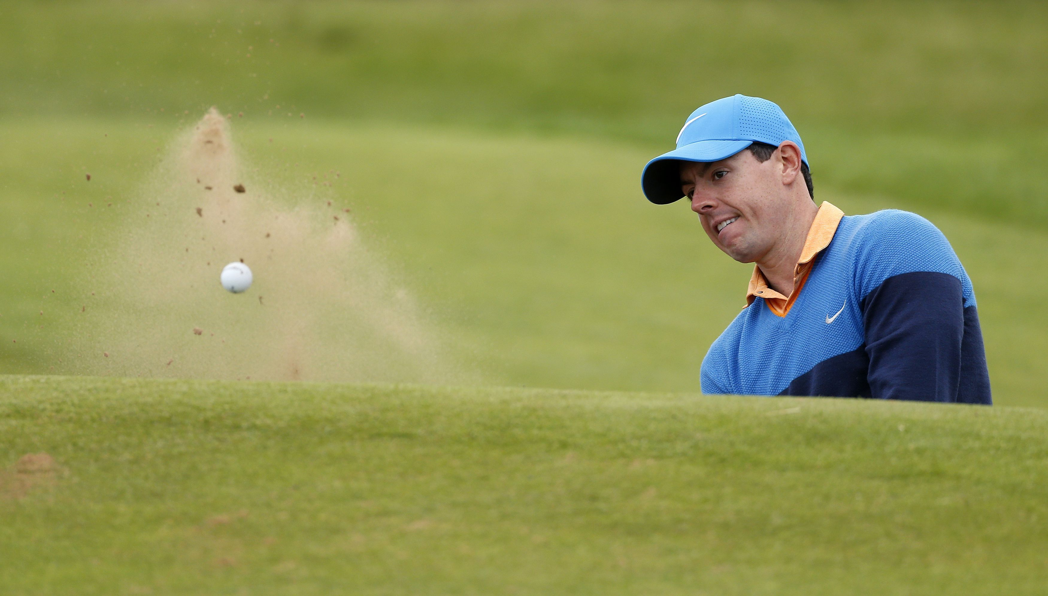 Rory McIlroy escapes a bunker at the fifth during yesterday's practice round at Royal Troon.