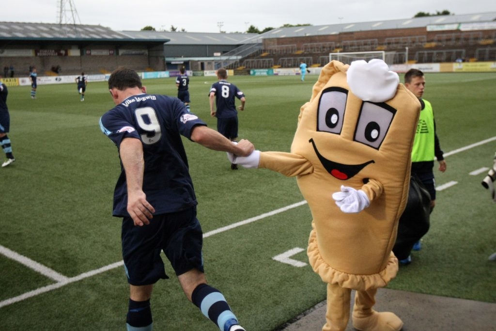 Baxter the Bridie gives the players pre-match moral support.