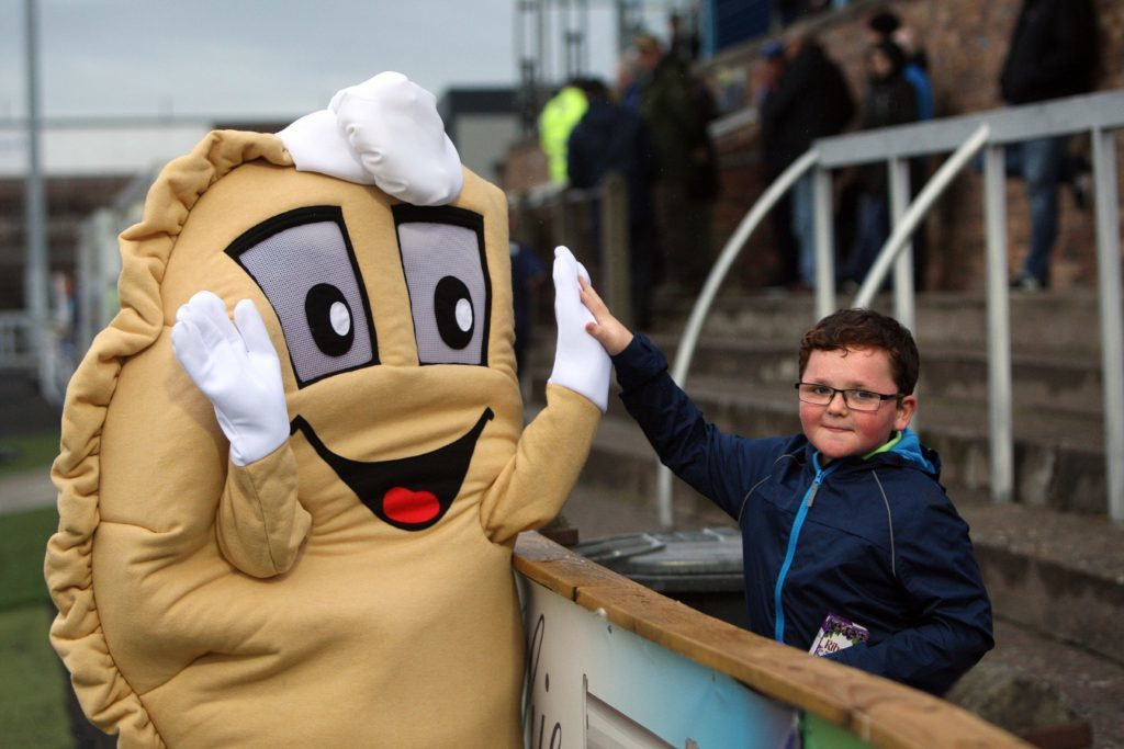 Baxter the Bridie high-fives a young Forfar fan at Station Park.
