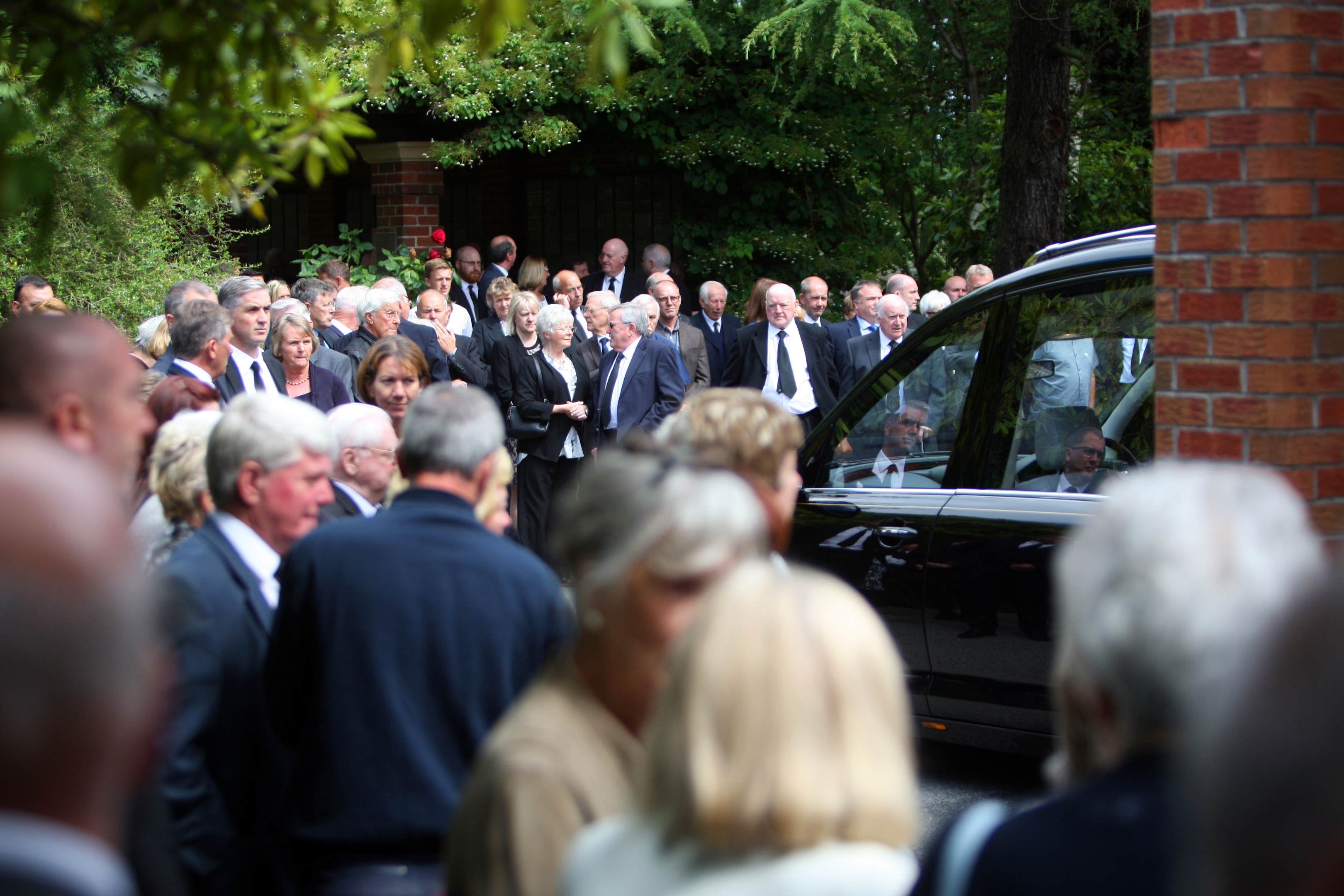 Hundreds of mourners gathered to pay their respects.