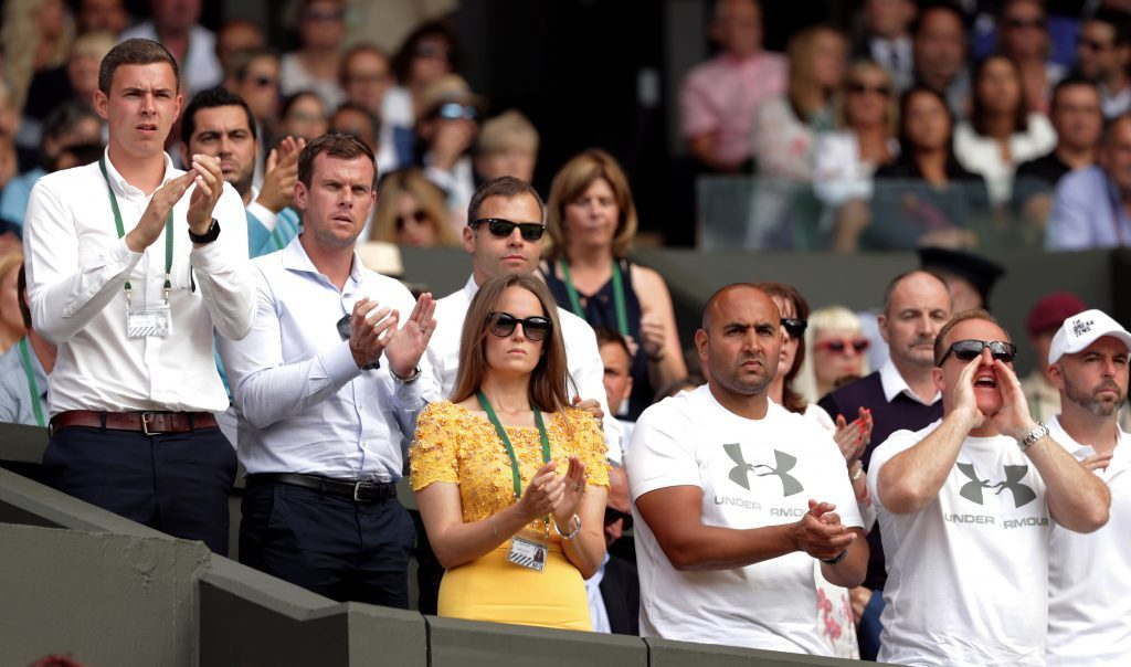 Wife Kim cheers her husband on from the players' box.
