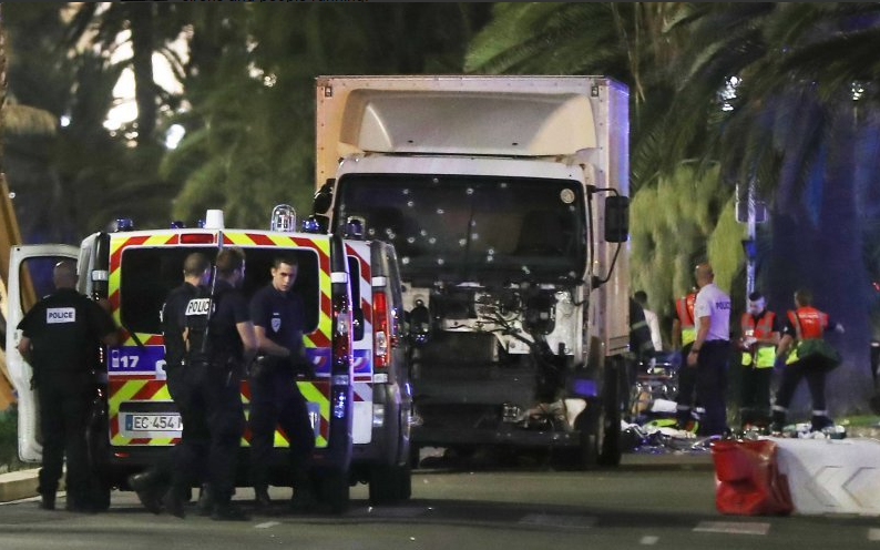 The lorry in Nice with bullet holes in the windscreen.