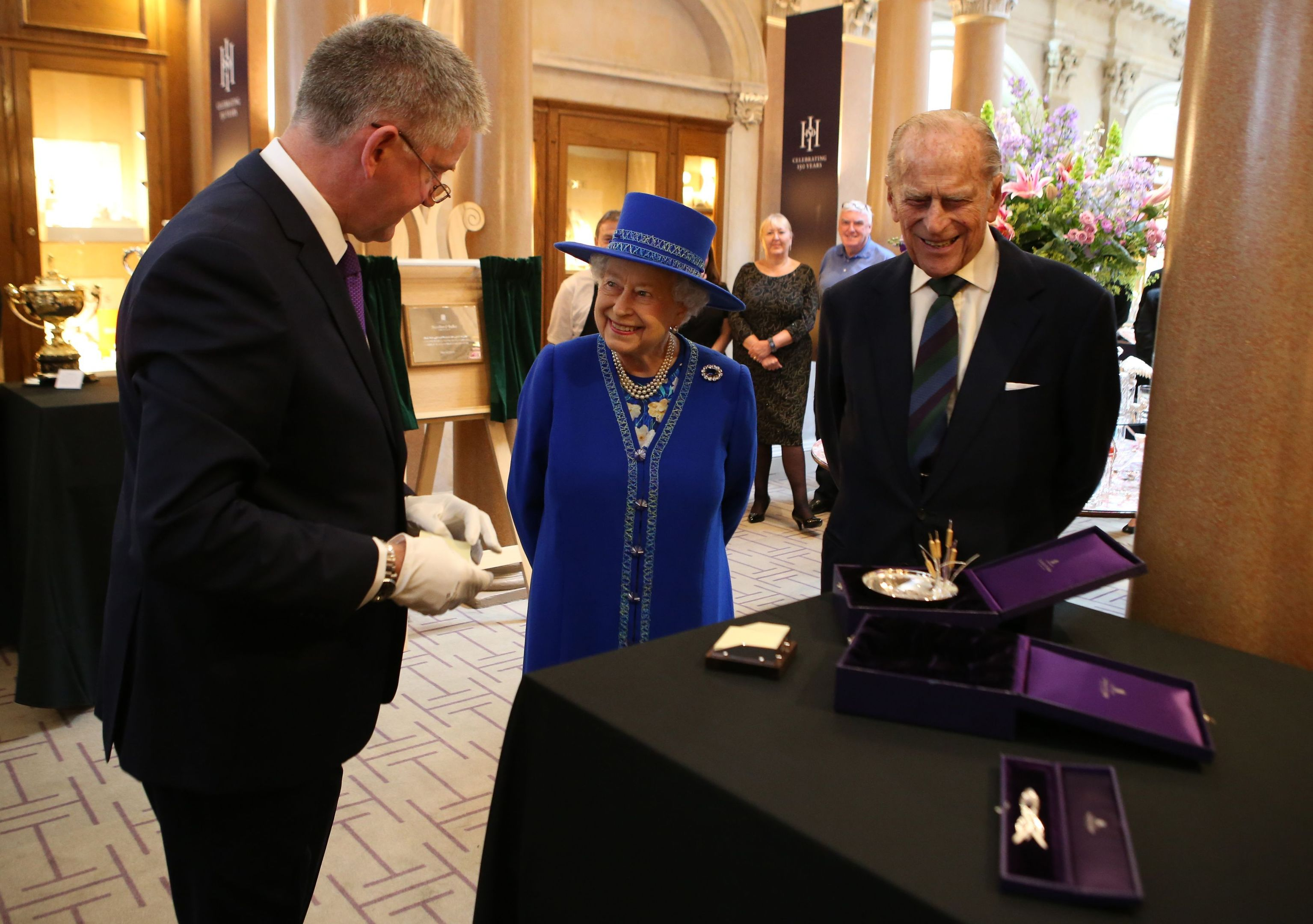 The Queen and the Duke of Edinburgh are presented with gifts by Chief Executive Stephen Paterson.