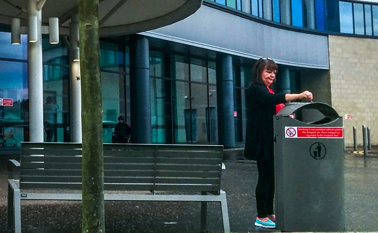 Smokers defy no-smoking signs at entrance to Victoria Hospital, Kirkcaldy
