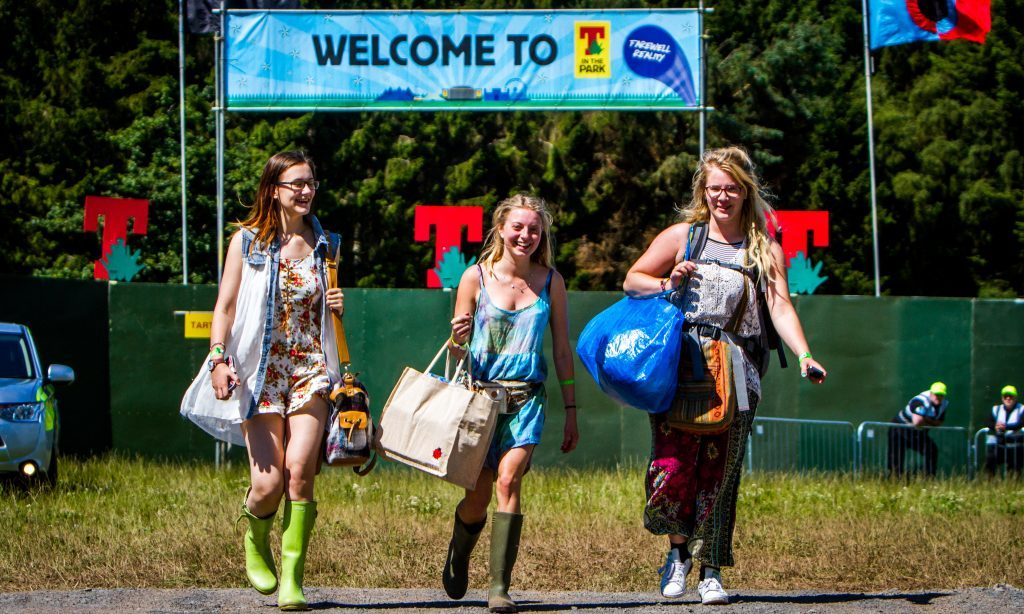 Three festival-goers arrive at the campsite for this year's T in the Park.