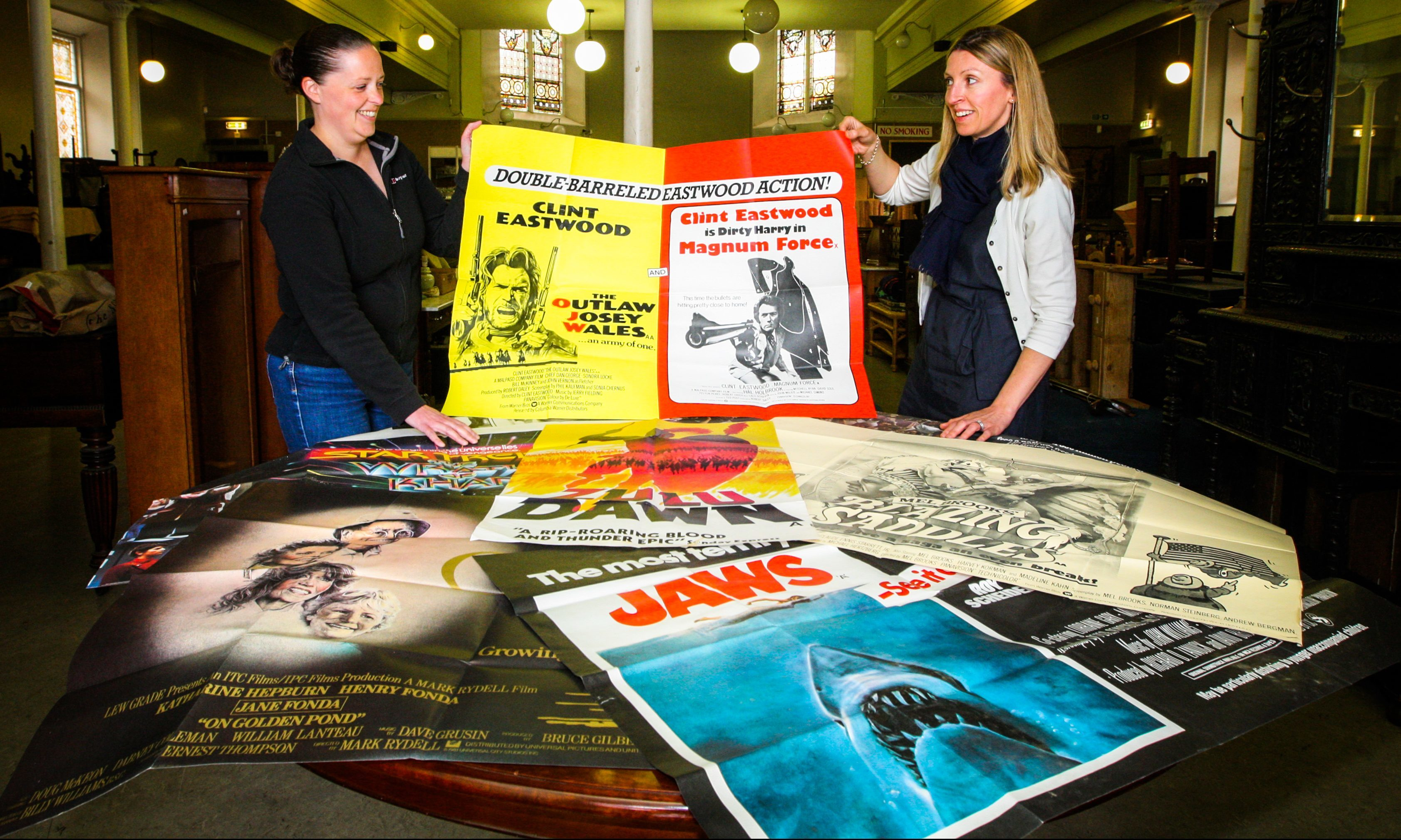 Jill Lambert (left) and Claire Burns with some of the items for auction.