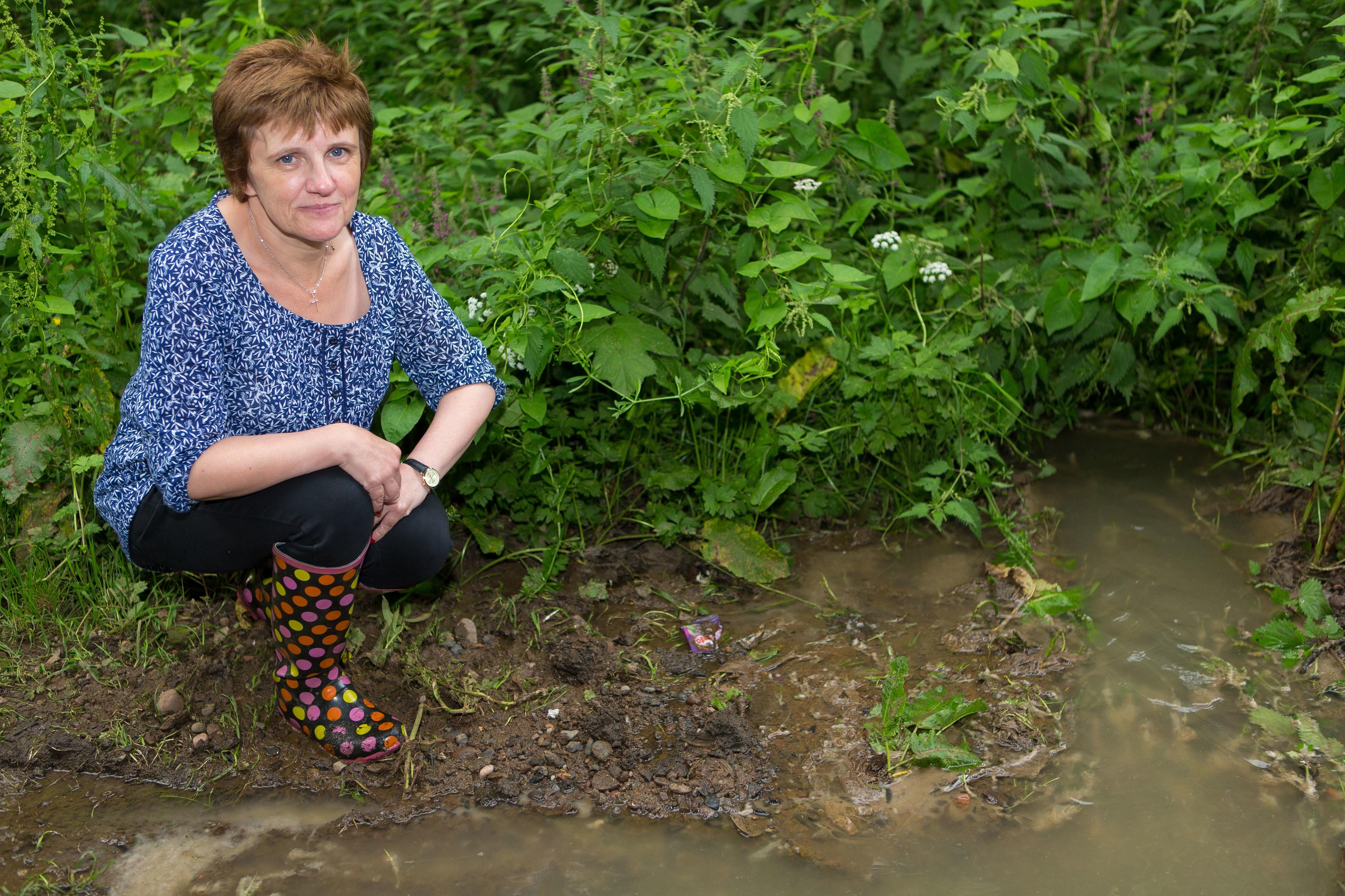 Councillor Judy Hamilton surveys the scene of the leak