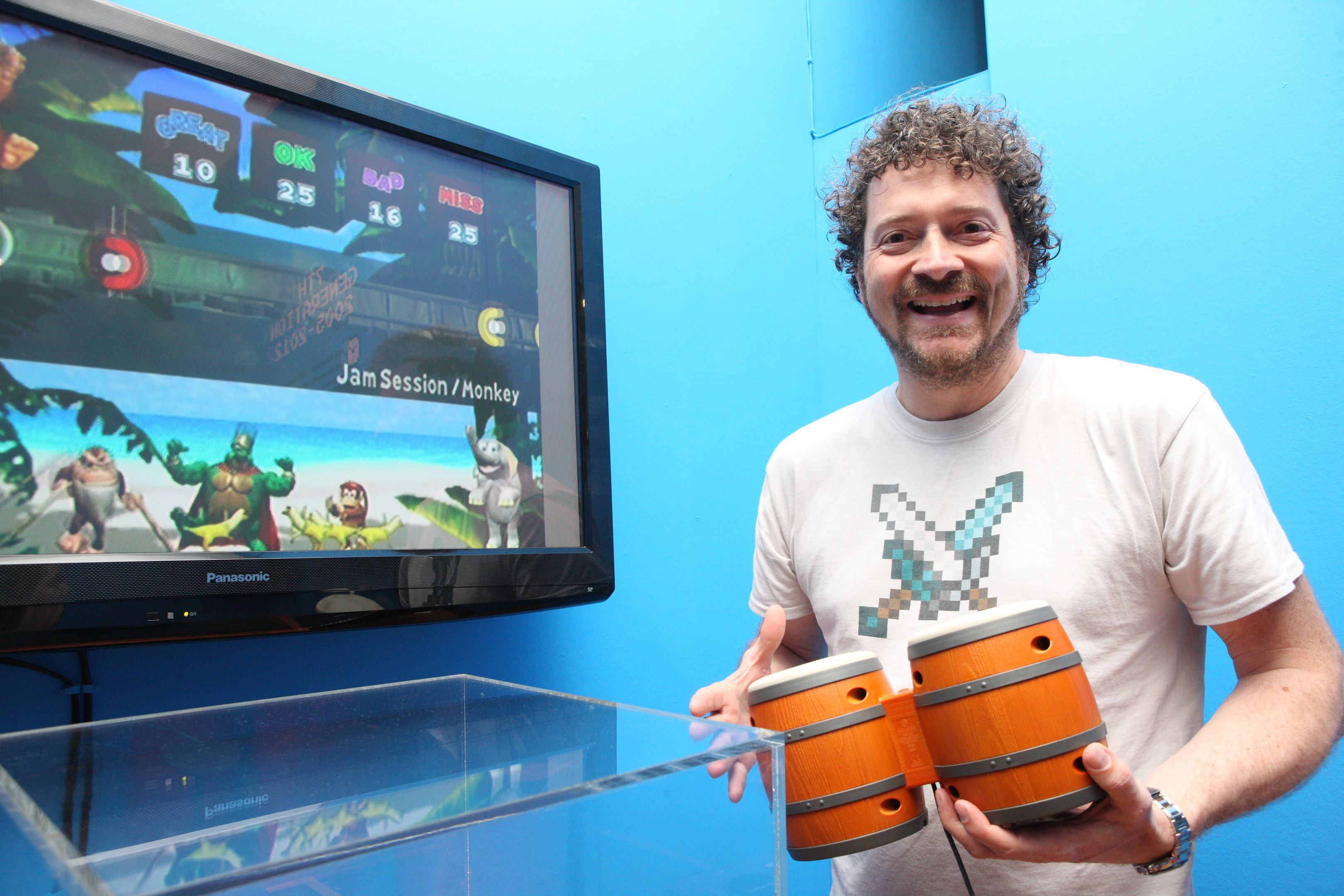 Chris van der Kuyl plays a video game at Perth Museum