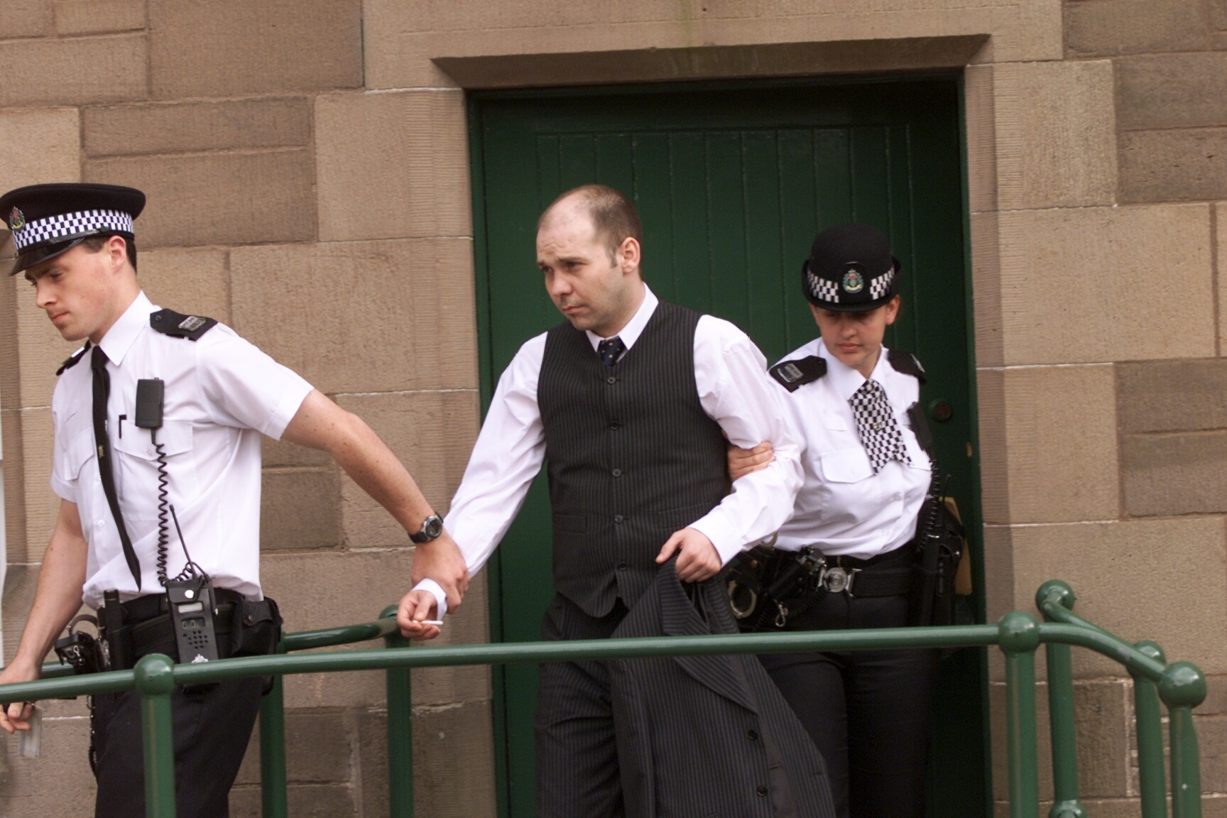 David Roache being taken from Forfar Court to begin his sentence for murder in 2002.