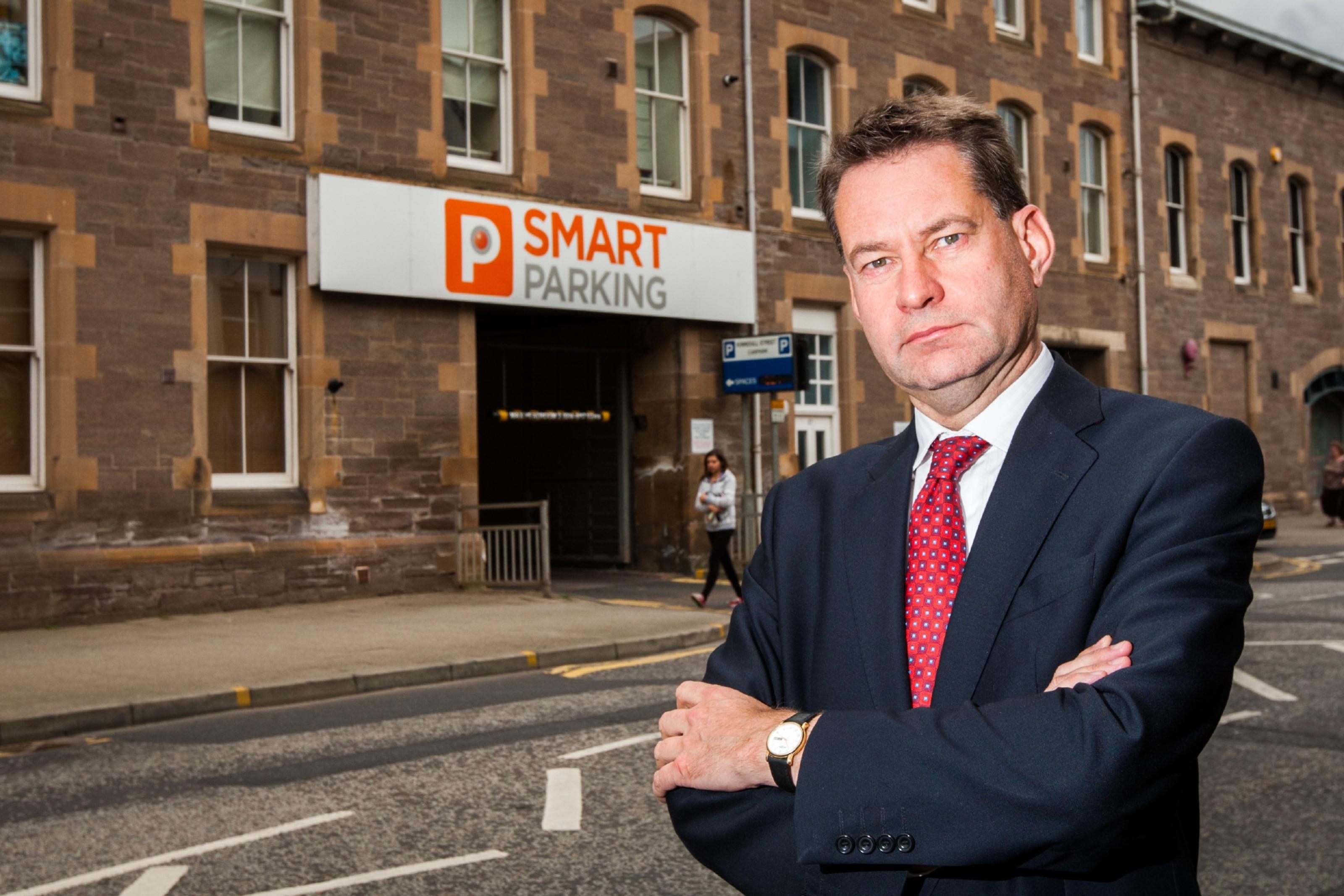 Murdo Fraser MSP outside the car park on Kinnoull Street.
