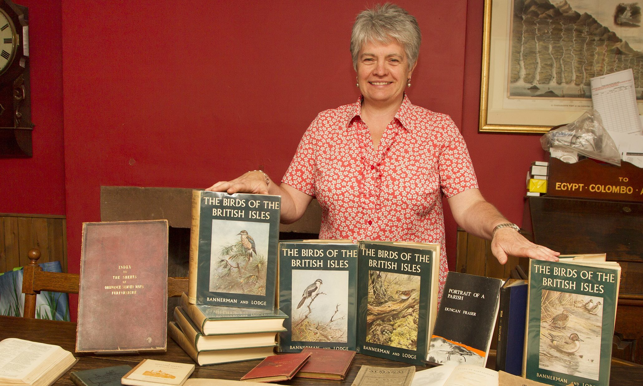 Organiser Hilary Farquharson with some of the old works.