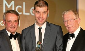 2015 Apprentice of the Year Alastair McLean with D&A College principal Grant Ritchie and Courier Business Awards host Nick Hewer.