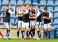 Declan McManus (2nd from right) celebrates his goal with his team-mates.