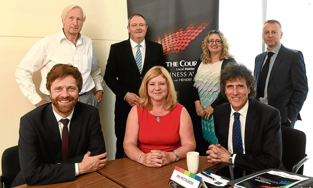 The judging panel for the Courier Business Awards 2016. Back from left: Nick Kuenssberg, Richard Neville, Alison Henderson, Philip Long. Front: David Smith, Jackie Waring and panel chairman Jim Pettigrew.
