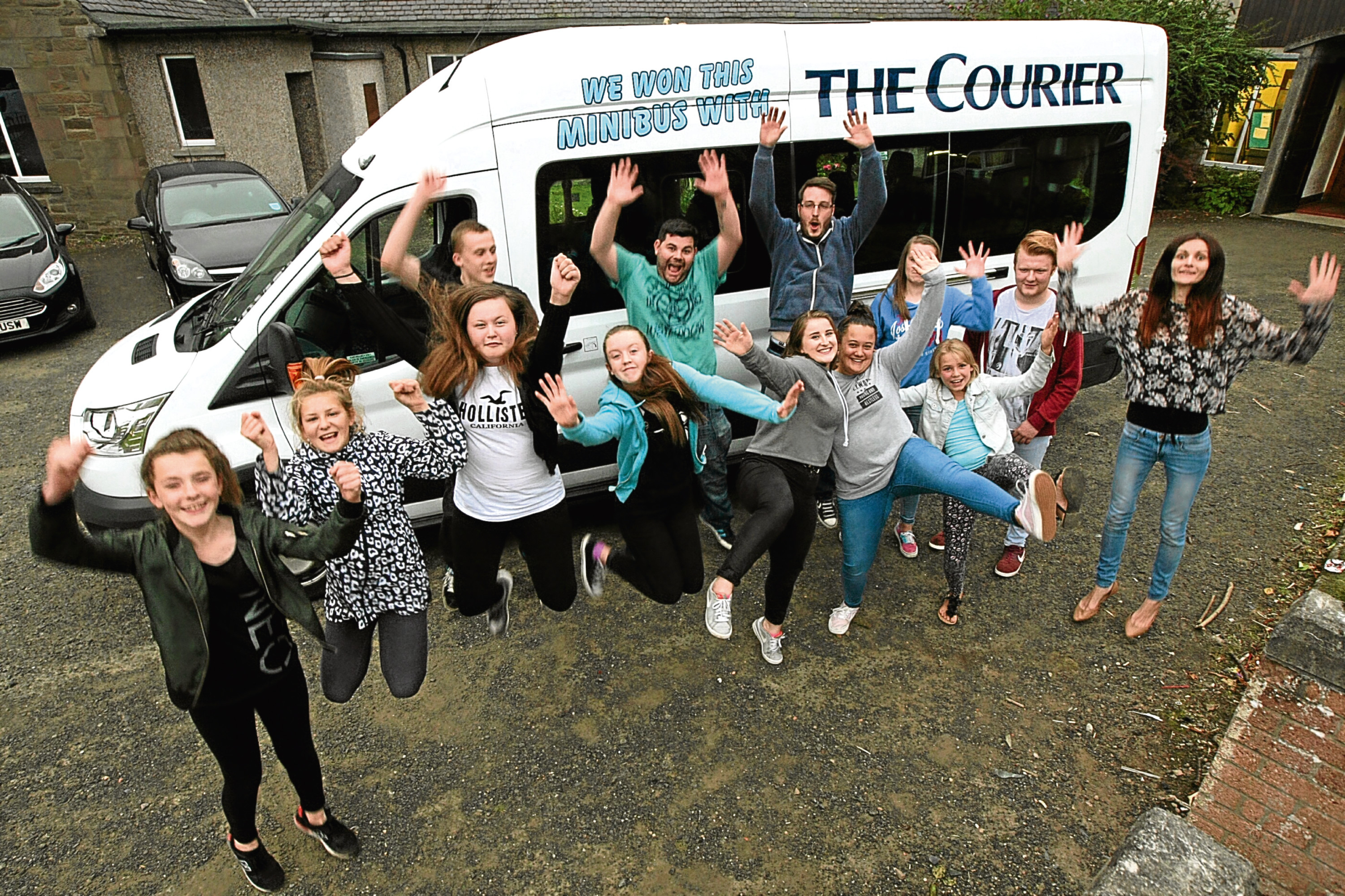 Happy travellers: the RockSolid Youth Project in Douglas with the minibus they won from The Courier.